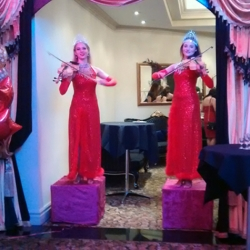 VIOLINISTS IN RED